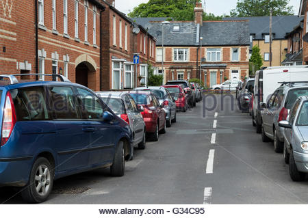Cars parked along both sides of the road in Fairfield Road, Blandford Forum, Dorset, England - Stock Photo