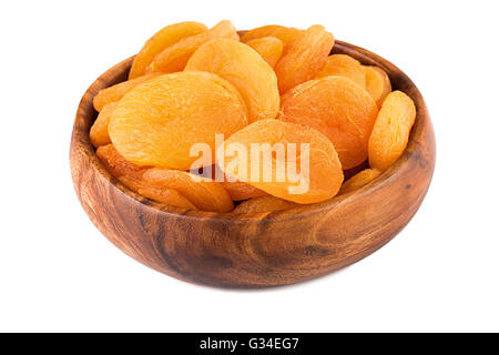 Dried apricots in a wooden bowl. Closeup. - Stock Photo