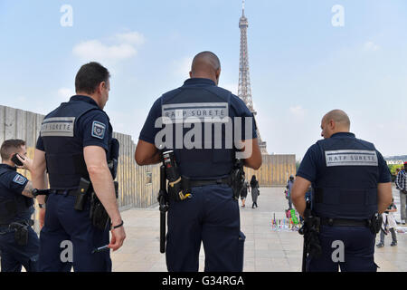 security personnel walk near the fence of a construction site at the palais du trocadero in