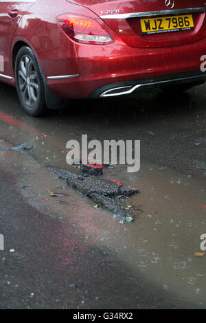 Purley, London, UK. 8th June, 2016. A section of damaged road following torrential rain. Credit:  Dave Stevenson/Alamy - Stock Photo