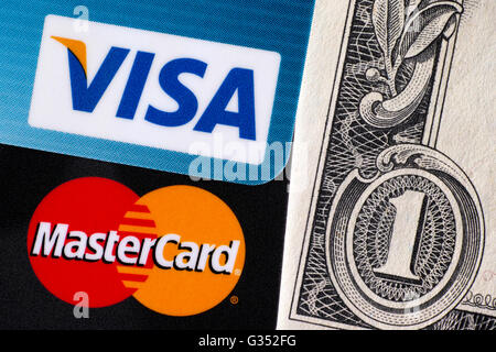 Tambov, Russian Federation - April 02, 2016 Visa and MasterCard logo on credit cards on one dollar bill. Studio - Stock Photo