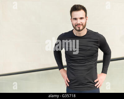 Jogger resting after running. Man runner taking a break during training outdoors in city. Young Caucasian male fitness - Stock Photo
