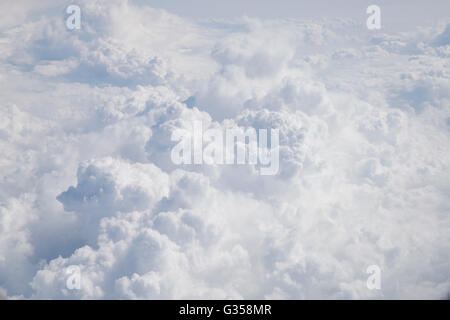 Beautiful, puffy clouds as seen from above. Cumulus clouds over the Atlantic Ocean. - Stock Photo