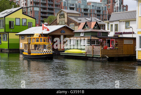 Fisherman's Wharf in Victoria, British Columbia with apartment beyond. - Stock Photo