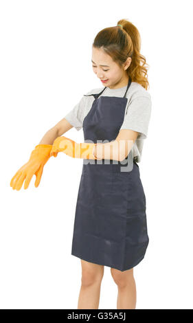 Asian Woman Wearing Rubber Gloves. - Stock Photo