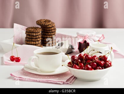 Breakfast. Tea with chocolate chip cookies on a white tray. Selective focus. - Stock Photo