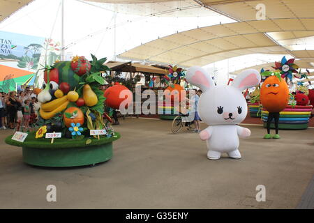 MILAN, ITALY - JUNE 29 2016: Foody, Expo 2015 Mascotte, during the parade through people - Stock Photo