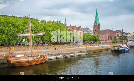Historic town of Bremen with old sailing ship on Weser river, Germany - Stock Photo