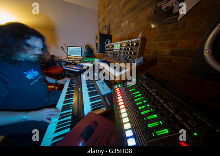 Home music studio with multiple electronic keyboards - Stock Photo