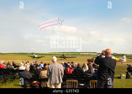 People watching the RAF Red Arrows performing, Duxford Airshow, UK - Stock Photo