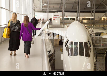 People looking at a Concorde airplane in the 'Airspace' hangar, Imperial War Museum, Duxford, Cambridgeshire UK - Stock Photo