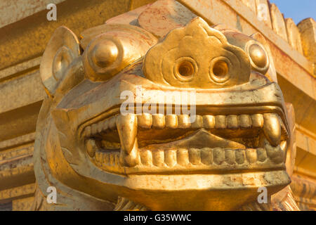 Golden statue structure  in the front of stupa, shining in late afternoon sun, Architecture, Myanmar, Burma, South - Stock Photo