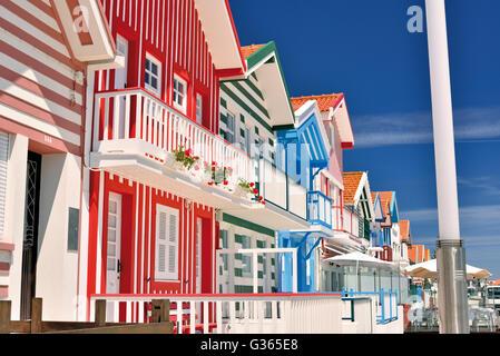 Portugal: Lateral view of colorful former fishermen´s houses 'Palheiros da Costa Nova' - Stock Photo