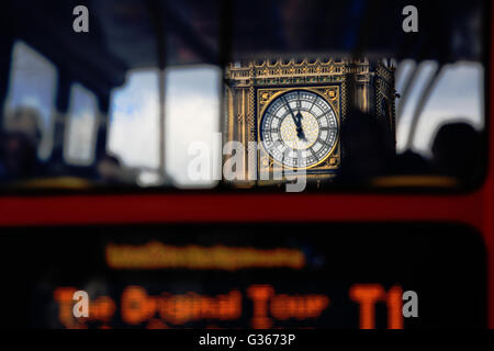 A vew, through a London tour bus, of the clock on Elizabeth Tower (Big Ben) in London, England. - Stock Photo