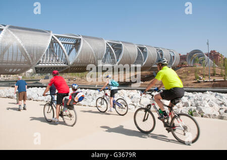 Perrault bridge and cyclists. Madrid Rio Park, Madrid, Spain. - Stock Photo