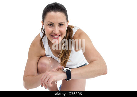 Portrait of athlete woman checking time in wrist watch - Stock Photo