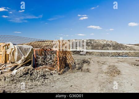 Old Rusty scaffold pipe clamp, mounting parts of scaffolding, placed in metal pallet on construction site. - Stock Photo