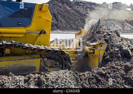 Detail on caterpillar while he moving ground. - Stock Photo