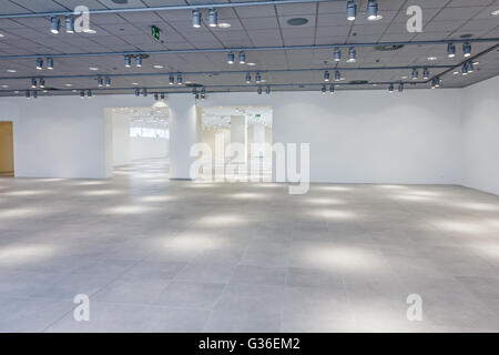 View on large showroom in a modern business centre with ceiling lamps. - Stock Photo