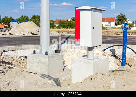 energy electric plug on a concrete wall stock photo royalty wall new small distribution fuse box on construction site next to the pole base and hydrant