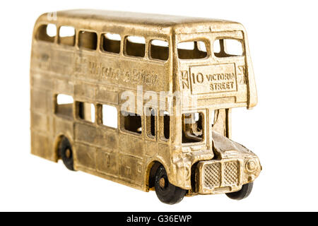 a vintage retro double decked british bus toy isolated over a white background - Stock Photo