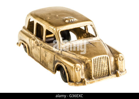 a vintage metal taxi car model isolated over a white background - Stock Photo