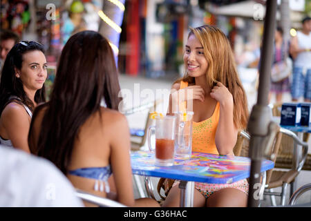 3 Female tourists exploring the city of Puerto Vallarta, Jalisco, Mexico - sitting at a table at street side restaurant, - Stock Photo