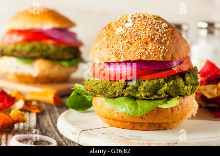 Homemade Green Vegan Burgers with Lettuce and Tomato - Stock Photo