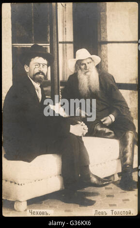 Russian playwright and writer, Anton Pavlovich Chekhov (1860-1904), left, with Russian writer, Leo Tolstoy (1828 - Stock Photo