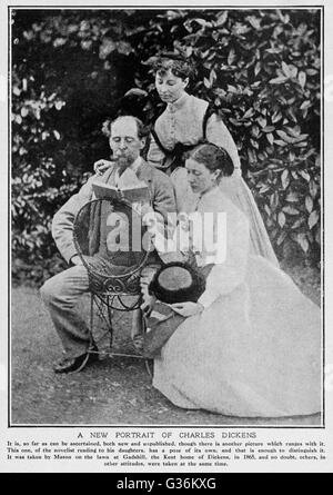 CHARLES DICKENS (1812-1870) English writer at his home at  Gadshill in Kent, with his  daughters Kate (standing) - Stock Photo