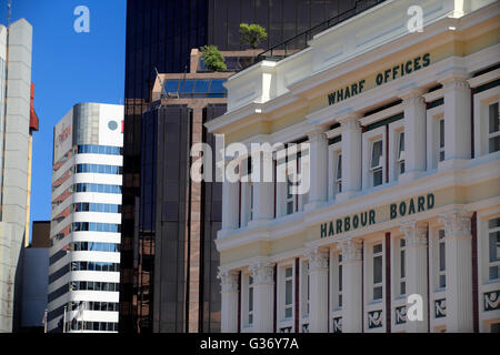 Wellington's Harbour Board's wharf offices with modern office building behind - Stock Photo