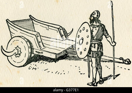 An Ancient Briton with his war chariot. Note the sold form of the wheels and the addition of scythe blades to cause - Stock Photo