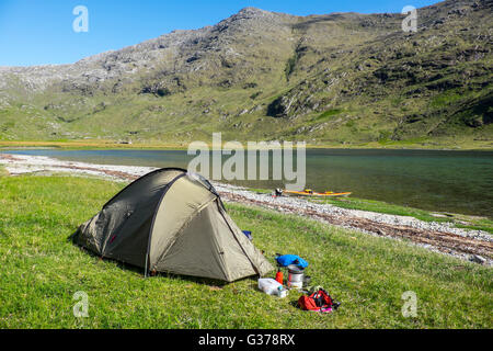 Wild camping at the head of Loch Nevis, Knoydart, Scotland as part of a sea kayaking expeditio - Stock Photo