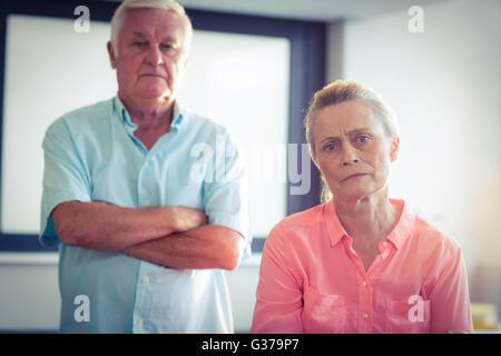 Portrait of unhappy senior couple - Stock Photo