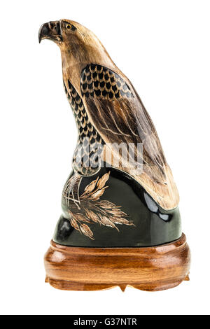a bird of prey wooden sculpture isolated over a white background - Stock Photo