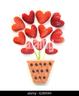 Strawberries in a flower pot concept - Stock Photo