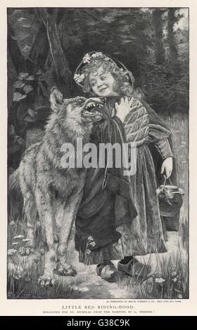 Red Riding Hood smiles down on  the wolf.  The wolf shows his  teeth in reply - Stock Photo