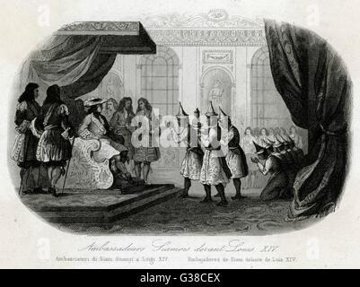 King Louis XIV receives  Siamese Ambassadors from his  throne. - Stock Photo