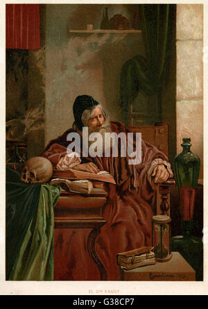 Faust at his studies muses on  the power of magic - Stock Photo