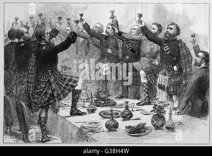 Scotsmen drink the health  of the duke of Rothsay,  with Highland Honours        Date: 1872 - Stock Photo