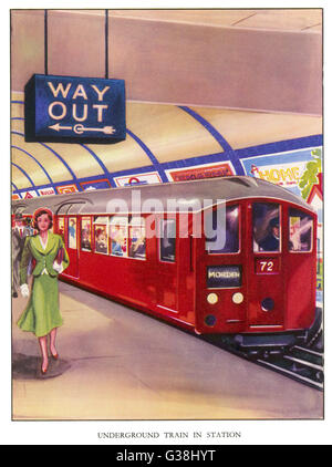 A Northern Line train in the standard red colour, on its way to Morden, southwest London    C.1948 - Stock Photo