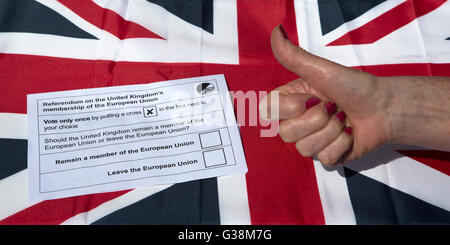 A ballot paper for the United Kingdom referendum on European Union membership. A hand gives a thumbs up sign next - Stock Photo
