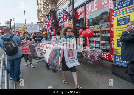 London, UK. 9th June 2016. 'No Pride in War' protesters, including military and gay pride veterans, march down Whitehall - Stock Photo