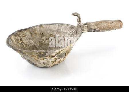 Old used hand bucket for trowel isolated on white - Stock Photo