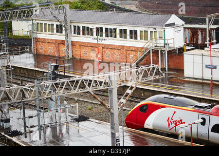 Stockport train station Alstom Class 390 Pendolino  electric high-speed train operated by Virgin Trains heading - Stock Photo