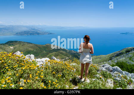 A Young Woman Looking At The Views From Mount Pantokrator, Corfu Island, Greece - Stock Photo