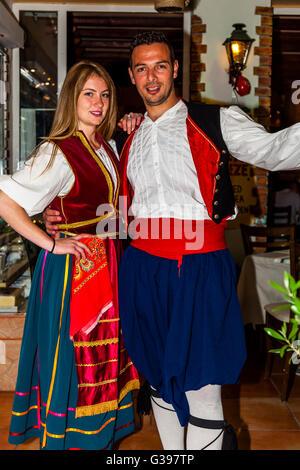 Traditional Greek Dancers Performing At A Restaurant In Sidari, Corfu, Greece - Stock Photo