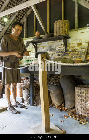 Part of a display at the Roman Garden Museum at Fishbourne Roman villa shows a reconstruction of a slave's working - Stock Photo