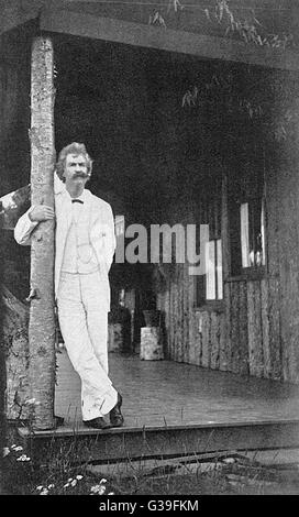 MARK TWAIN (Samuel L Clemens) American writer, standing on a verandah,  leaning on a post...      Date: 1835 - 1910 - Stock Photo