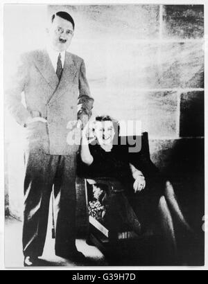 German fuhrer, Adolf Hitler, in relaxed pose with his mistress Eva Braun (1912-1945), at his mountain home, The - Stock Photo